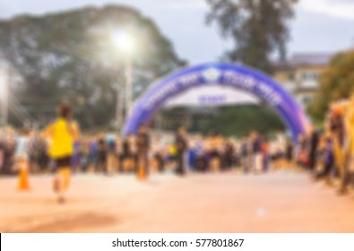blurred image of people in the marathon racing at the finished point in the morning