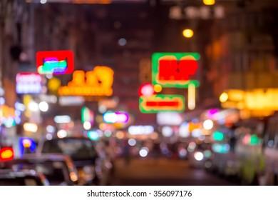 blurred image of people moving in night city  Jordan neighborhood street. Art toning abstract urban background. Hong Kong
