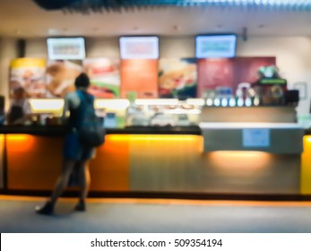blurred image of people order their food at the counter of fast food shop , coffee shop