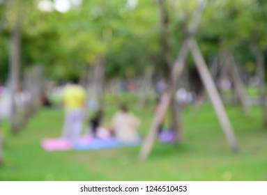 Blurred image of people picnic in the park