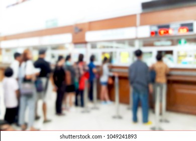 Blurred image of people queuing for hospital services.