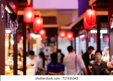 Blurred image of people shopping at japan food fair,blur for background