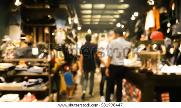 Blurred image of people in shopping mall, vintage color