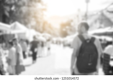 Blurred image of people shopping at street market use for background, retro tone color filtered