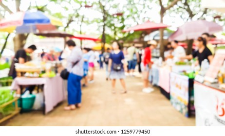 Blurred image of people at street market ,use  for background. (vintage tone)