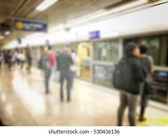Blurred image of people waiting the next metro  in rush hour.