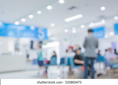Blurred image of people waiting to see a doctor in hospital. For