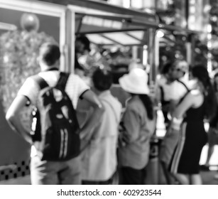 Blurred image of people waiting for their food at a food truck