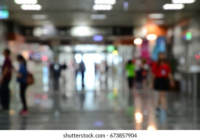 Blurred image of people walking in  aisle