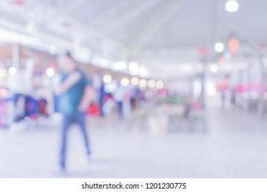 Blurred image of people walking at day market blur background with bokeh .