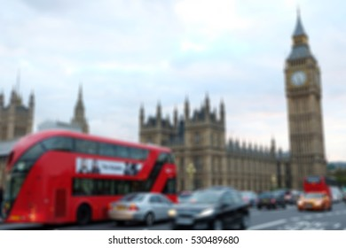 Blurred image of People walking on the street, with car, Big Ben and House of Parliament, London in background.