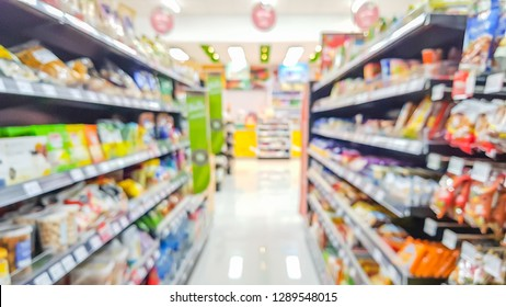Blurred image of product shelves in convenience stores.
