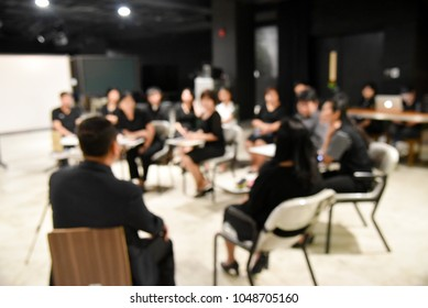 blurred image of production and business team is sitting and standing for plane and discussion about workshop, the chairman is talking with the advertisement project in television studio station room