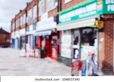 Blurred image of a row of small convenience shops, corner stores in a residential area, London, UK.