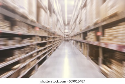 Blurred image of shelves in modern distribution Warehouse With Zoom Effects.Wholesale, Logistic, Business, Export, Suppliers and Online Store Concept