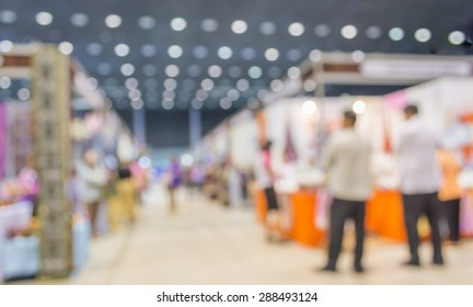 blurred image of shopping mall and people for background usage .