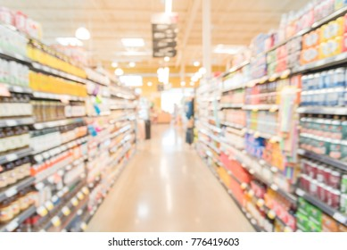Blurred image of sodas, bottled teas, juices, protein, energy drinks aisle in store at Irving, Texas, US. Supermarket shelves with variety products display. Defocused abstract background, bokeh light