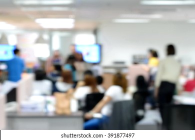 Blurred image of staffs meeting informally in morning working day
