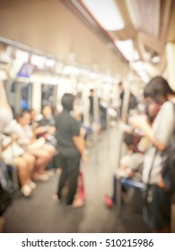 Blurred image of still life photography with people in train