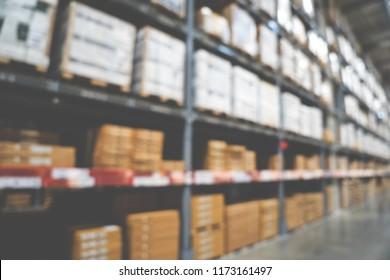Blurred image of stock inventory shelf, modern logistics smart warehouse management of wholesale or distributor background concept.