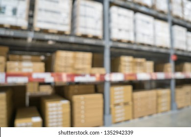 Blurred image of stock inventory shelf, stack of carton boxes, modern logistics smart warehouse management. For wholesale distributor, ecommerce, commercial business or supply chain background concept