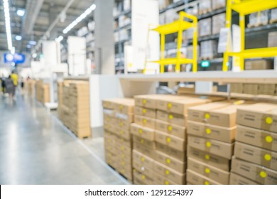 Blurred image of stock inventory, stack of brown paper carton boxes, modern logistics smart warehouse management. Houseware, furniture wholesale distributor business or supply chain background concept