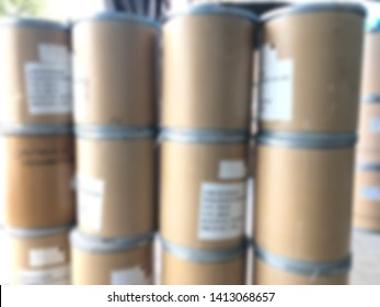Blurred image Storage of Brown paper tank,stock of goods in warehouse,container packaging for chemicals,medicine,flour,cosmetic,fertilizer,dry food and more.