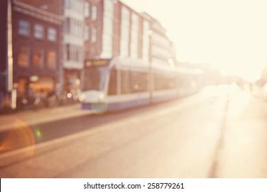 Blurred image a street.