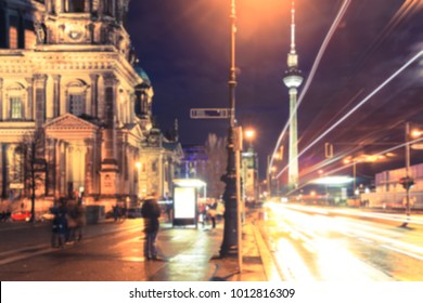 Blurred image street view of St. Mary Church and TV Tower at night in Berlin, Germany.