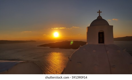 Blurred image of sunset, caldera and the dome at Fira, Santorini in winter 2016
