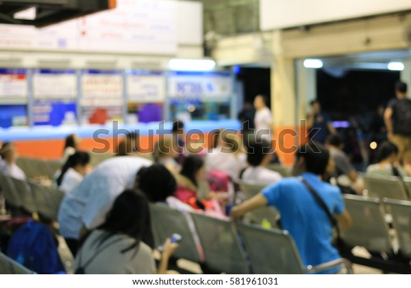 Blurred image of tourist and people in transportation waiting for the bus on vocation in long weekend at night time ,Abstract background