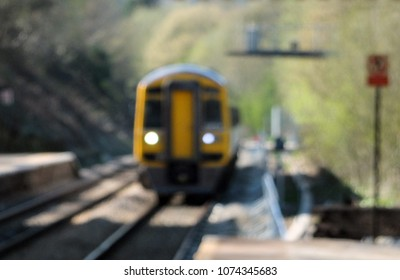 blurred image of a typical suburban pacer train arriving in a small railway station