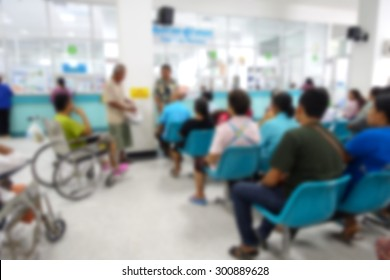 Blurred image of unidentified people and patient in hospital waiting medicine or doctor.