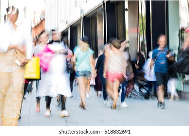 Blurred image of walking people. Londoners and tourists walking in Oxford street, one of the main shopping destination of London