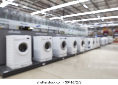 blurred image of washing machines in the store