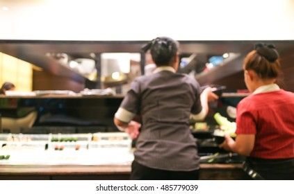 Blurred image women are choosing food in Buffet Restaurant