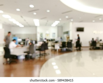 Blurred image of workers at open office environment