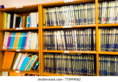 Blurred images of bookshelves in the library