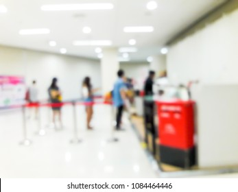 Blurred images of people queuing up counter service.