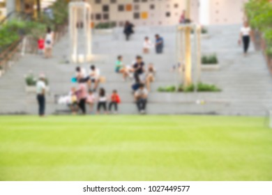 Blurred images of people sitting, walking, talking, relaxing in the outdoor recreation.