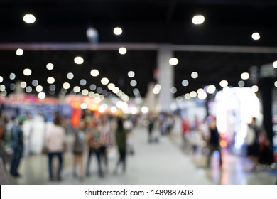 Blurred images of trade fairs in the big hall. image of people walking on a trade fair exhibition or expo where business people show innovation activity and present product in a big hall.