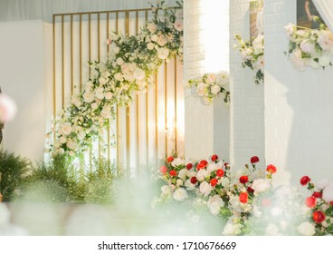 Blurred images of wedding ceremony at night,The white backdrop is decorated with beautiful flowers and leaves for the wedding of the couple.