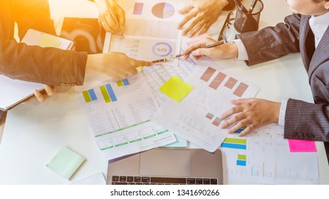 Blurred images,A group of business people talking about the business reports of the project planning board in the meeting room and summarizing the total of privatization of real estate in the project