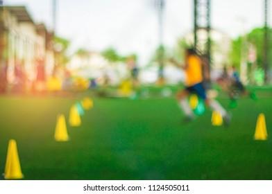 Blurred - Indoor soccer practice, artificial turf, For children in summer.