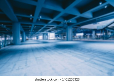 blurred interior in airport at night