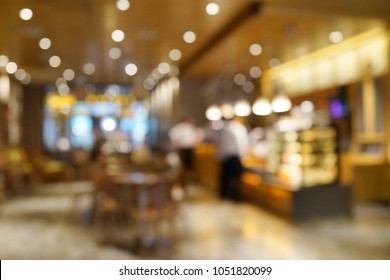 Blurred interior background of a cafe or coffee house.