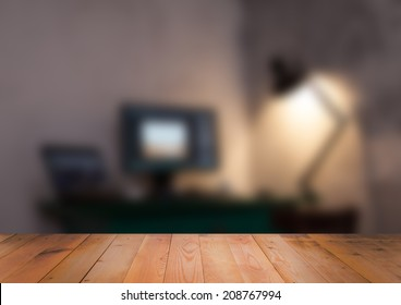 Blurred interior of room with wooden surface