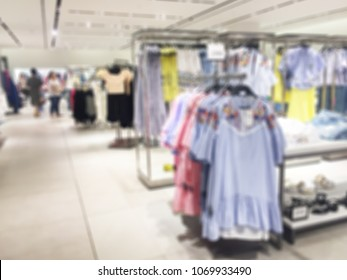 Blurred Interior of Women's Fashion Department in Shopping Mall
