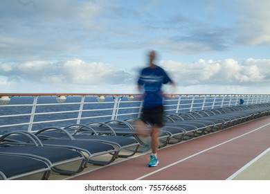 Blurred Joggers on cruise ship running track