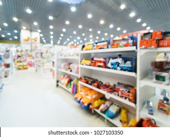 Blurred of kids toy store background with bokhe. shelves and aisle of kids toy shop interior, copy space